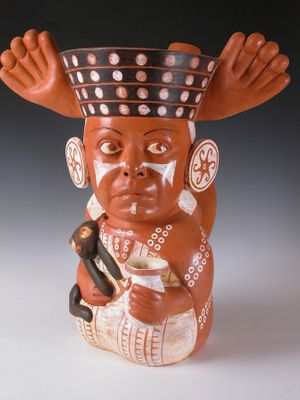 Kukuli Velarde, Chola de Mierda , 2006. Terracotta with engobes and wax, 20 x 17 x 17 inches. Collection of the Artist. Photograph courtesy of Doug Herren