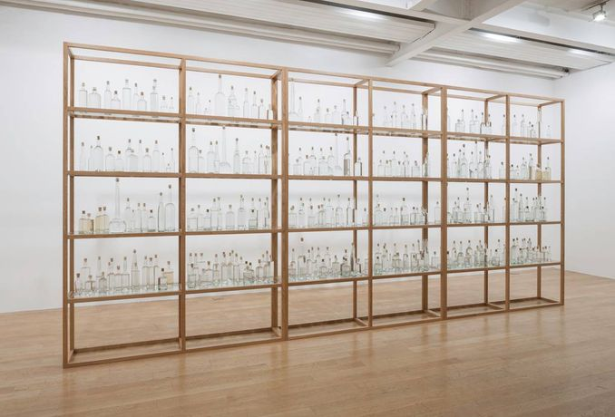 Tania Kovats, All the Sea, 2012 - ongoing, seawater, glass, cork, oak, (365 bottles), 600 x 278.5 cm. Installation view: The Fruitmarket Gallery, Edinburgh. Courtesy the artist and Pippy Houldsworth Gallery, London. Photo: Ruth Clark