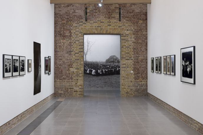(Foreground) Photographs by Ming Smith, (background) Arthur Jafa, Installation view 'A Series of Utterly Improbable, Yet Extraordinary Renditions', Serpentine Sackler Gallery, London (08 June 2017 – 10 September 2017). Image © Mike Din