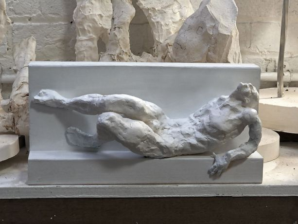 Maurice Blik, working, plaster maquette for a reclining figure.