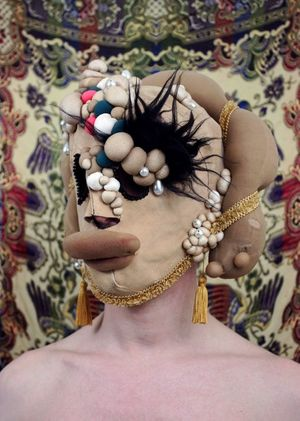 Mehryl Levisse Sixtus Pavonina, 2015 leather, tights, kapok, sequins, pearls, make-up, human hair, thread, pompom, eyelets, gold wire size fit to artist's head