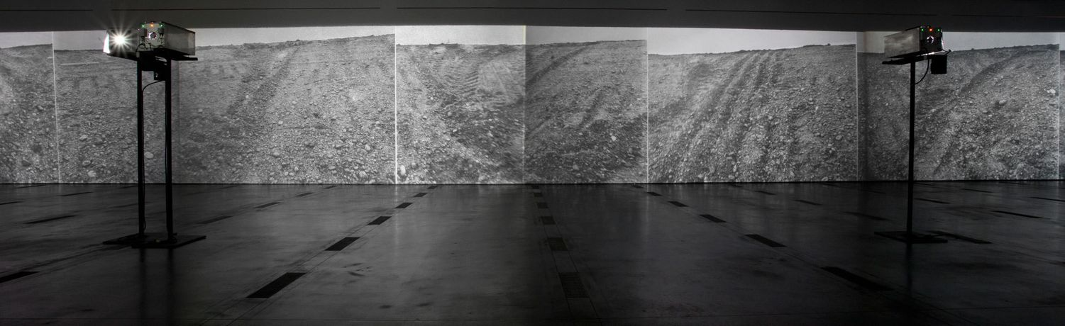 Michael Heizer (b. 1944), Actual Size: Munich Rotary, 1970. Six custom made aluminum projectors with steel stands and six black and white slides mounted between glass, Dimensions variable. Whitney Museum of American Art, New York; Gift of Virginia Dwan  96.137. Photograph © Museum Associates/ LACMA, CA