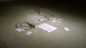 Touching, performance with microphone and script fragments, 2016. Claire Potter. Image courtesy of the artist.