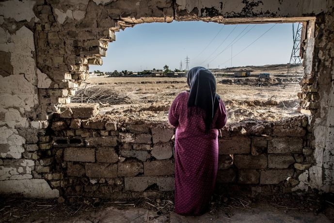 Caption Zahia* Hassan (name changed), 28 is divorced with a 4-year-old son. She lives in a house on the outskirts of a small village called Husseini, not far from Jalawla town. Her village was taken over by ISIS and her house was one of the last to be taken.