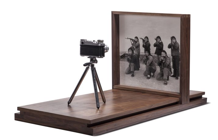 Cai Dongdong, Aiming at the Camera, 2017. Gelatin silver print, camera, wood, 47 1/4 x 22 1/16 x 19 11/16 inches (120 × 56 × 50 cm). Edition of 3. © Cai Dongdong, courtesy Klein Sun Gallery