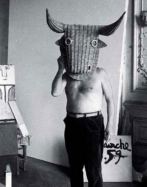 Picasso wearing a bull's head intended for bullfighter's training, La Californie, Cannes, 1959. Photo by Edward Quinn © edwardquinn.com.
