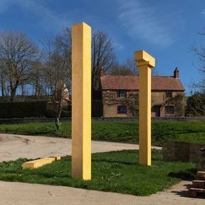 Álvaro Siza, columns for the Annenberg Courtyard at the Royal Academy (2014), installed at Drawing Matter, with view of the residence (behind), Shatwell Farm. Photo Guus Kaandorp