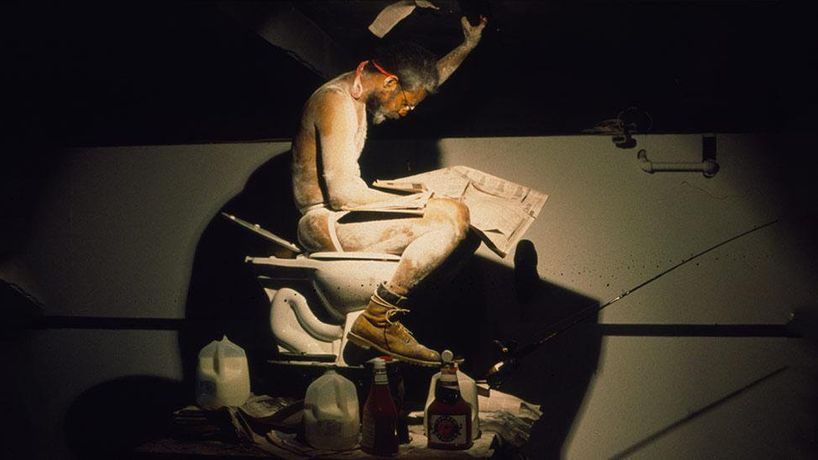 Pope.L, Eating the Wall Street Journal, 2000, at The Sculpture Center, New York, NY. Photo: Lydia Grey