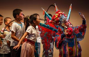 Year five student Chen Yue (right), also an actress of a local children's Peking Opera troupe, takes a selfie after performance in Haimen, east China's Jiangsu Province.(Xinhua/Huang The)