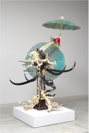 Rina Banerjee (b. 1963) Make me a summary of the world! She was his guide and had traveled on camel, rhino, elephant and kangaroo, dedicated to dried plants, glass houses—for medical study, vegetable sexuality, self-pollination, fertilization her reach pierced the woods country by country, 2014, wood rhino, Chinese umbrellas, sea sponges, linen, beads, pewter soldier, grape vines, glass chandelier drops, acrylic horns, wire, nylon and bead flower, 7 x 4 ft. Courtesy of the artist and Galerie Nathalie Obadia, Paris/Brussels, © Rina Banerjee, Image courtesy of Galerie Nathalie Obadia, Paris/Brussels