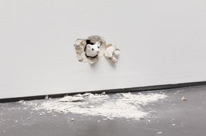 I… I… I…, 2019 An animatronic white mouse partially visible, emerging from a hole broken through the gallery wall. With the voice of the artist's 9 year old daughter, the mouse struggles and stutters as it attempts to deliver a speech, not quite knowing how to begin or what exactly to say. Image by Andrea Rosetti. Courtesy of Ryan Gander and Esther Schipper. © Ryan Gander