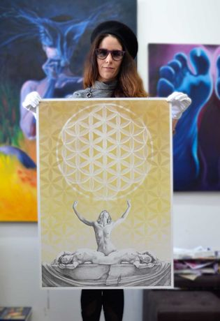 In the studio holding up Bliss Hysteria | Sacred Nude