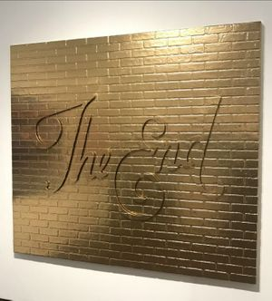 "Ryan McCann | ""The End"", 2018, 77"" x 88, gold acrylic and faux brick. Courtesy of exhibitor Axiom Contemporary"
