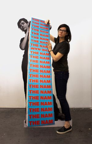 Fiona Banner with NAM stack (1997), c-type print, aluminium, courtesy the artist and Ikon
