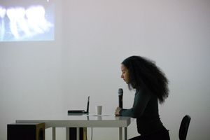 Deborah Joyce Homan. Reading at Towards the Philosophy of Jet Lag, a performance event instigated by Mohamed Almusibli at Auto Italia South East, London, 2019.