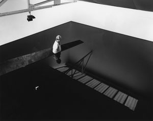 Richard Wilson, standing in the original installation of 20:50, Matt's Gallery, London, 1987.  Photo by Edward Woodman