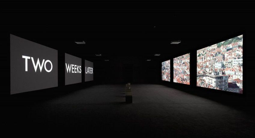 Stan Douglas, The Secret Agent, 2015. Six-channel video installation, eight audio channels, colour, sound; 53 minutes and 35 seconds, loop (with eight musical variations). Overall dimensions variable with installation (aspect ratio 4:3). Courtesy of the artist, David Zwirner gallery, New York and London, and Victoria Miro gallery, London. View of the exhibition Stan Douglas. Interregnum, Museu Coleção Berardo, 2015. Photograph: David Rato.