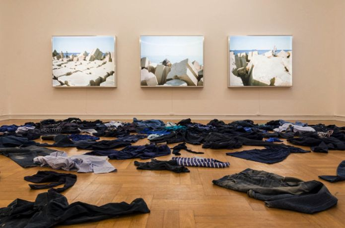 "Kader Attia  Dead Sea. 2015  Installation. Clothes and three lightboxes, 130 × 160 × 18 cm each.  Type of installation at the exhibition ""Against the current. Journey to the unknown. Morsbroich Museum, Leverkusen. 2018  Courtesy of the artist  Photo: Riccardo Frankelucci"