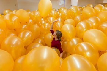 Martin Creed, Work No. 1190: Half the air in a given space, 2011, gold balloons.