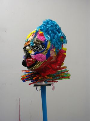 Balance Head (2013) Beads, wool, thread, plastic,  fabric with steel vice and broomstick on carpet    150  x 50 x 50 cm approx Gilda Mautone (b. 1974 Italy)