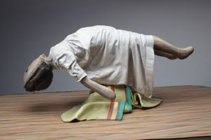 Cathie Pilkington, Levitating Doll, 2010. Wood, steel, clay, fabric, lino, paint 28 x 90 x 52 cm.
