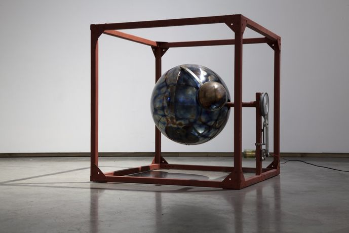 Abducted Planet, 2016, Stainless steel and wood with electric motor, 26 x 26 x 26 in