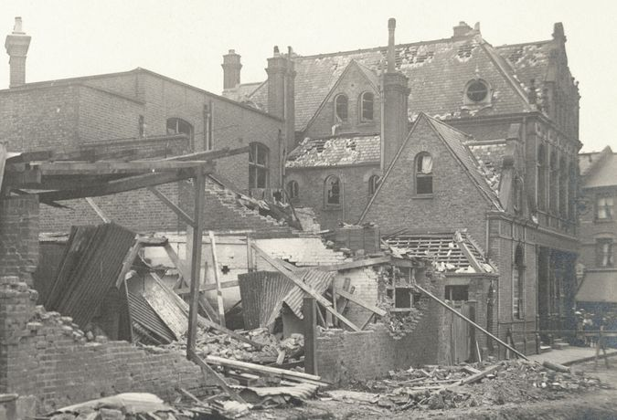 A battered Rose & Crown pub following an air raid, 1918 ©Vestry House Museum