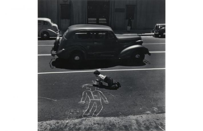 John Gutmann, The Artist Lives Dangerously, San Francisco, 1938; gelatin silver print; 14 x 11 in.; BAMPFA, promised gift of Victoria Belco and William Goodman in memory of Teresa Goodman. John Gutmann, © 1998 Center for Creative Photography, Arizona Board of Regents.   Christine Osinski: Boy Pointing Rifle at Car, 1983–84; gelatin silver print; 20 x 24 in.; BAMPFA, promised gift of Victoria Belco and William Goodman in memory of Teresa Goodman.   Christian Marclay: Seattle, 2005; Chromogenic print; 11 x 8 1/4 in.; BAMPFA, gift of Victoria Belco and William Goodman in memory of Teresa Goodman. © Christian Marclay, courtesy of Paula Cooper Gallery, New York.