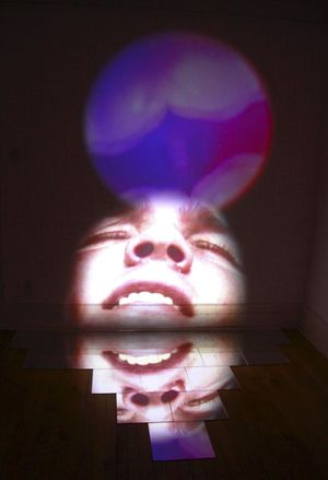 Ivan LOZANO - 'FANTASY VISION MEDITATION Version 2'- Video projection, Mirror tiles - 120x96x60cm - 2009