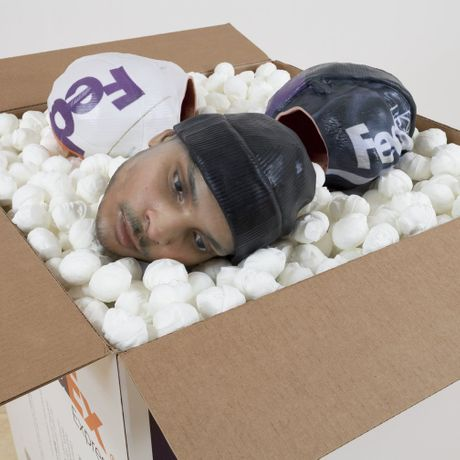 Josh Kline, Packing for Peanuts (Fedex Worker's Head with Knit Cap), 2014. Photo: Joerg Lohse