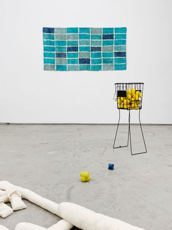 Wall (2015) 84cm x 168cm Silk Blend, Axminster wool, hemp, liquid latex  Ice Lemon Tea (2019) 85cm x 36cm x 36cm Tennis ball cage, spray paint, lemons