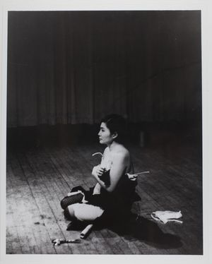 Yoko Ono performing Cut Piece (1964) at Carnegie Recital Hall, NYC. March 25, 1965. Photo by Minoru Niizuma ©Yoko Ono