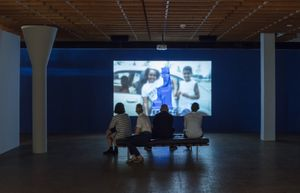 Sondra Perry, IT'S IN THE GAME '17 or Mirror Gag for Vitrine and Projection, 2017, single channel video, loop, color, sound, 16′34′′, installation view. Akademie der Künste (Hanseatenweg). photo: Timo Ohler