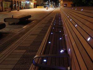 Esther Rolinson's Drift, a long public bench dotted with LED lights at night time.